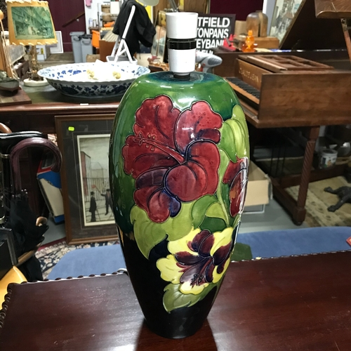 353B - A Large Moorcroft Hibiscus pattern table lamp. In a working condition. Measures 42cm in height inclu...
