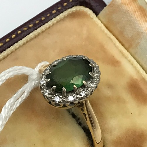 2J - Antique Victorian 18ct gold ladies ring set with a single green round stone surrounded by diamonds. ...
