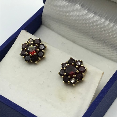 3J - A Pair of ladies antique 9ct gold and garnet cluster earrings. Weighs 2.2grams....
