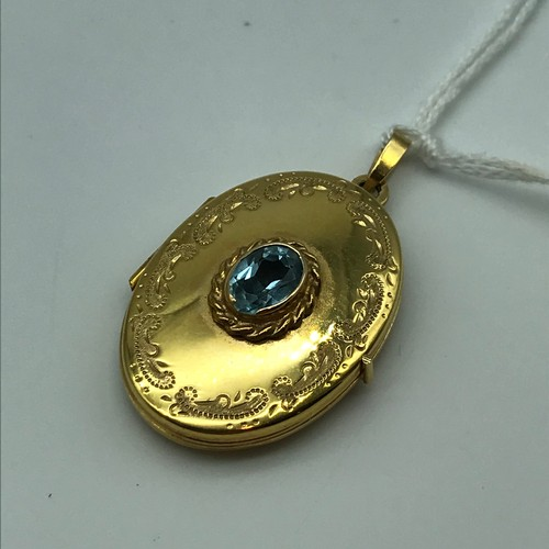 13J - A Ladies 9ct gold locket pendant designed with a single blue aquamarine stone [total weight 4 grams]...