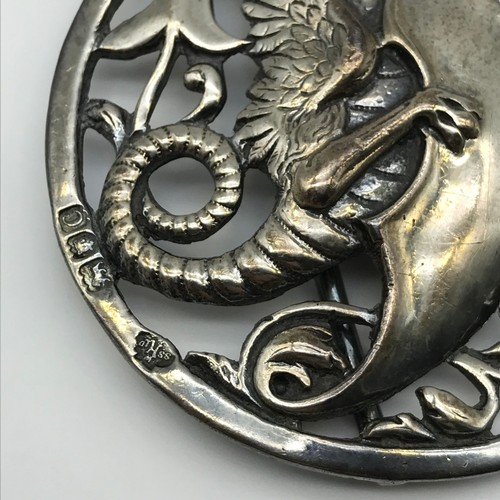 17 - A heavy London silver belt buckle, design shows two dragons holding shields [William Hutton & Sons L...