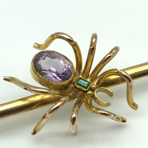 15 - Antique 9ct gold spider bar brooch, detailed with a large amethyst gem stone and an emerald cushion ...