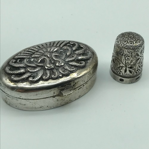 12 - An 800 Grade silver Persian pill box, lid is detailed with two peacocks with feathers spread, togeth...