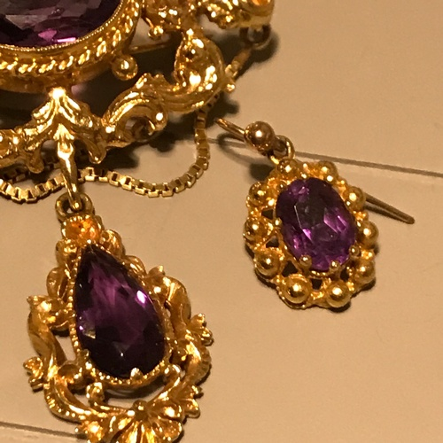 72J - A Beautiful Antique 9ct gold and amethyst brooch with matching earrings. Gems tested by presidium ge...