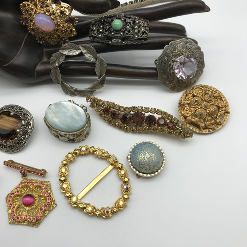 11J - A Box containing a quantity of Vintage costume brooches to include Silver leaf brooch and ornate sil...