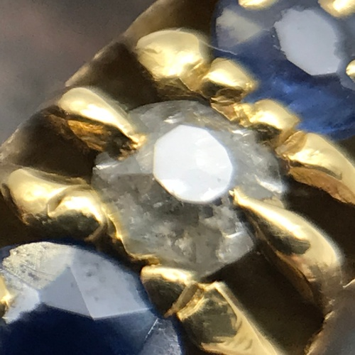 17J - An antique 18ct gold ladies ring set with two round cut diamonds and three Blue Topaz stones. Ring s...