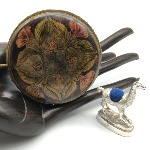 30J - A Possible silver lama figure pin cushion together with An Art Nouveau Mauchline ware style pin cush...