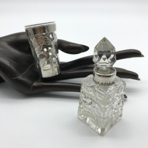 32J - A Vintage shot glass overlaid with Sterling silver together with Birmingham silver perfume bottle wi...