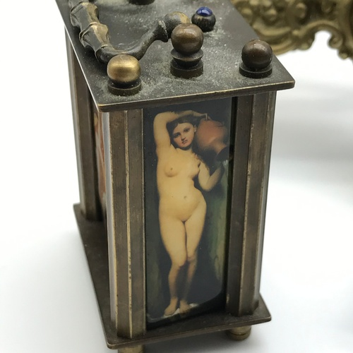 36J - A quantity of collectables to include a reproduction carriage clock detailing nude lady panels [Auto...
