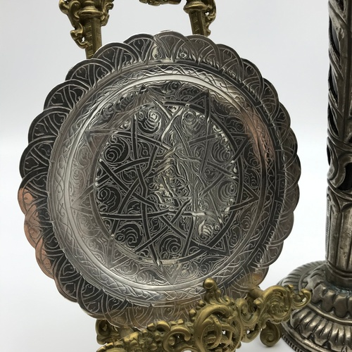 37J - An Egyptian silver hallmarked ornate engraved dish [13.5cm diameter & weighs 73.5grams] together wit...
