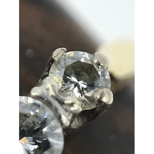 70J - A Beautiful 18ct gold and platinum three diamond ring. Ring size O and weighs 2grams...