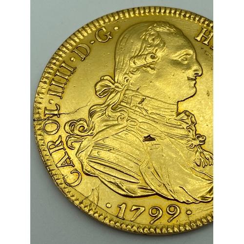 3 - 1799 Carol IIII 8 Escudos Gold coin. [Mint mark M] Diameter of coin 3.7cm. [Weighs 26.73 grams]...