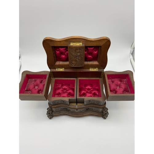 8 - A Beautifully made 19th century Black Forest jewel box. Detailed with hand carvings of flowers and f...