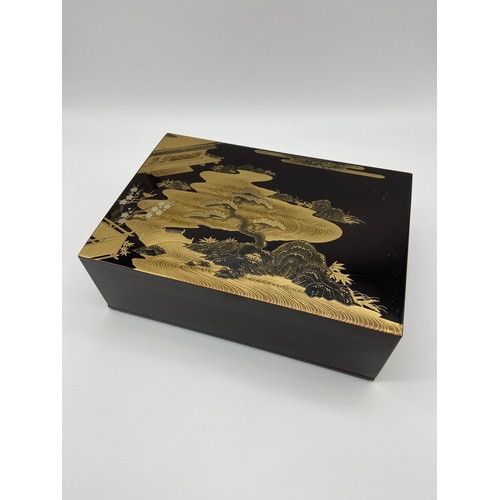 9 - A Highly detailed Chinese/ Japanese lacquered box, detailed with gilt painted courtyard scene showin...