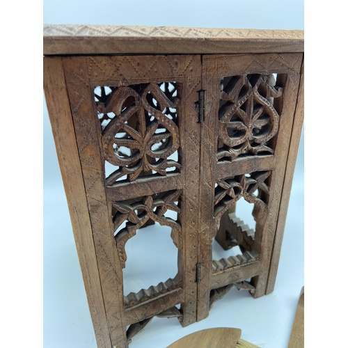 13 - A small hand carved Indian style table together with a small wooden dust brush and shovel. Table is ...