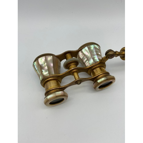 16J - A Pair of antique mother of pearl and brass opera glasses....