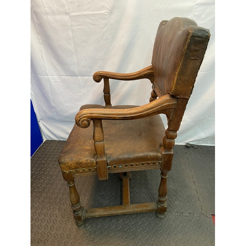 18 - A Victorian Ships oak carver chair. Upholstered with original leather and stud finish. Fitted with c...