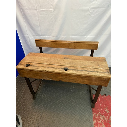 20 - An early 1920's Kingfisher ltd oak and cast metal double school desk. Has a lift top desk area, Also...