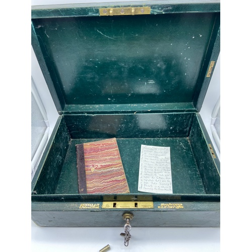 23 - Antique green leather dispatch carry box. Comes with key, book and note detailing whom the case belo...