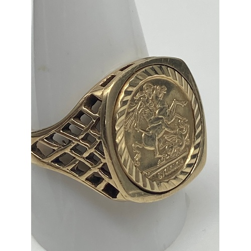 1J - A 9ct gold Gent's St George Medal Ring. [Size W, Weighs 6.42 grams]...