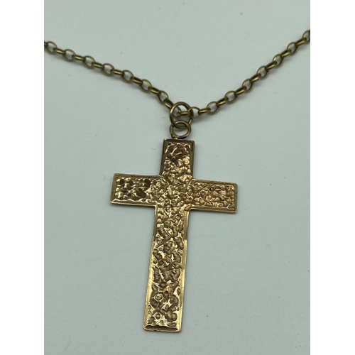 3J - A 9ct gold cross pendant together with a 9ct gold chain. [Total weight 8.05grams] [Chain 20 inch]...