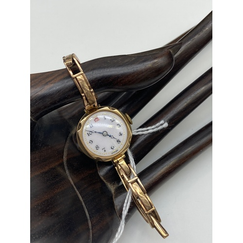 4J - An Antique Ladies 9ct gold cased and band watch. 15 Jewels workings. [Weighs 6.19 grams without work...