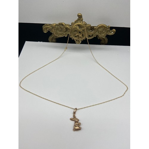 8J - A 9ct gold rabbit pendant with a 9ct gold necklace. [Weighs 1.53 grams] [16 inch chain]...