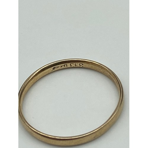 14J - A Gold band ring stamped '333' [Weighs 1.85 grams] [Ring size X]...