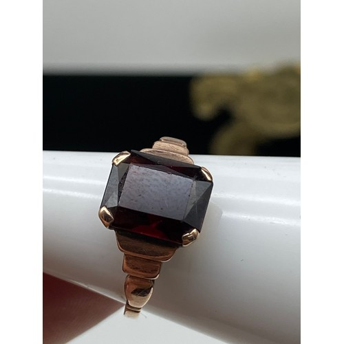 17J - An Antique 9ct gold ring set with a cushion cut red garnet stone. [Stone 10x8mm] [ Weighs 2.13 grams...