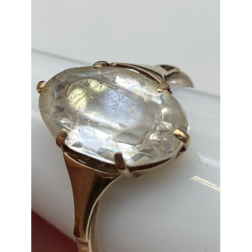 19J - An Antique ladies 9ct gold ring set with a large clear glass stone. [Weighs 2.21 grams] [Ring size P...