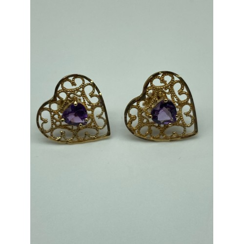21J - A Pair of 9ct gold heart shaped earrings set with a heart shaped amethyst stone centre. [Weighs 1.41...