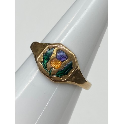 24J - A Possible Gold signet ring designed with enamel painted thistle. [Weighs 2.17 grams] [Ring size M]...