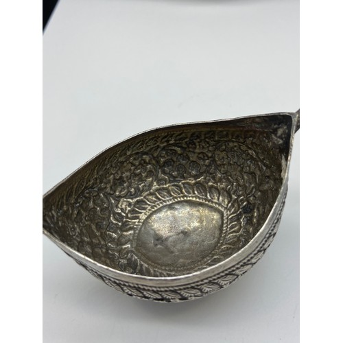 25J - Antique Indian silver two handled drinking vessel/ cup. Handles are in the style of snake heads.[5x1...