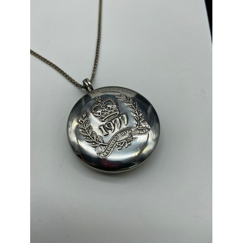 26J - A Birmingham silver locket detailed with the 1977 the Queens silver Jubilee embossed to the front. C...