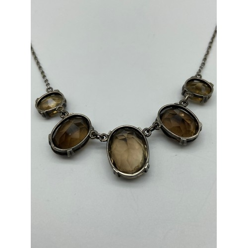 27J - A Lovely example of an Antique ladies silver and smokey quartz drop necklace. Consists of five gradu...