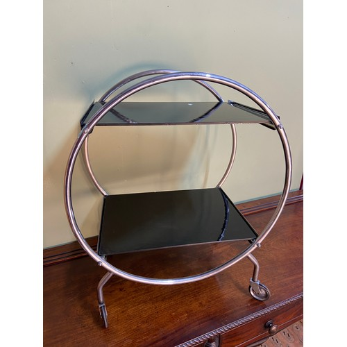 2 - An Art Deco chrome and glass savoy tea trolley. Fitted with black glass shelves and chrome round fra...
