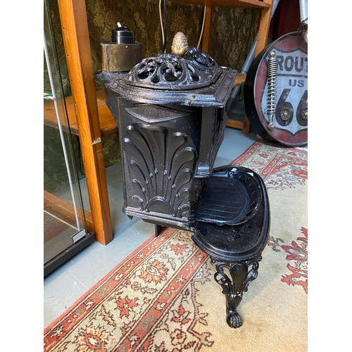 3 - Antique French cast iron wood burning stove, Fitted with a modern light fitting to the top. [55x49x4...