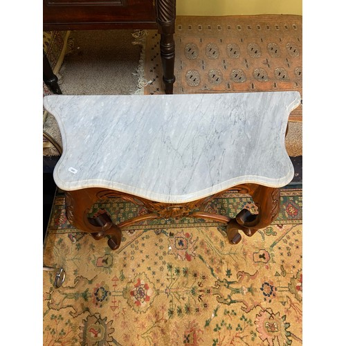 7 - A Reproduction ornate antique style console table, designed with marble top. [73x79x35.5cm]...