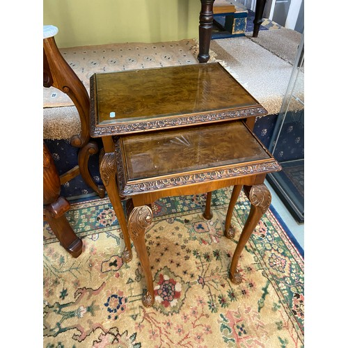 8 - A Set of reproduction burr walnut [2] nest of tables fitted with bevel glass insert tops. Supported ...
