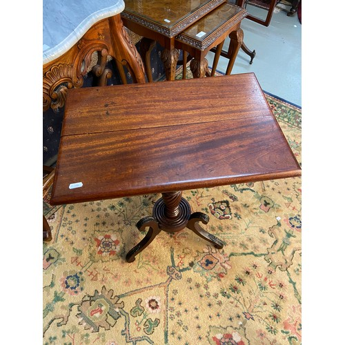 10 - A Georgian mahogany single pedestal support, flip top card table. Ornately carved with wreath design...
