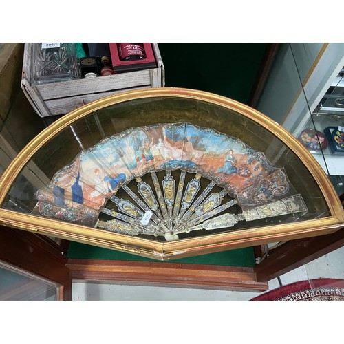 14 - Antique hand painted fan within a fitted glass and gilt painted wood case....