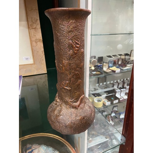 16 - An early 20th century Japanese dragon design onion shaped vase. Possibly Bretby....