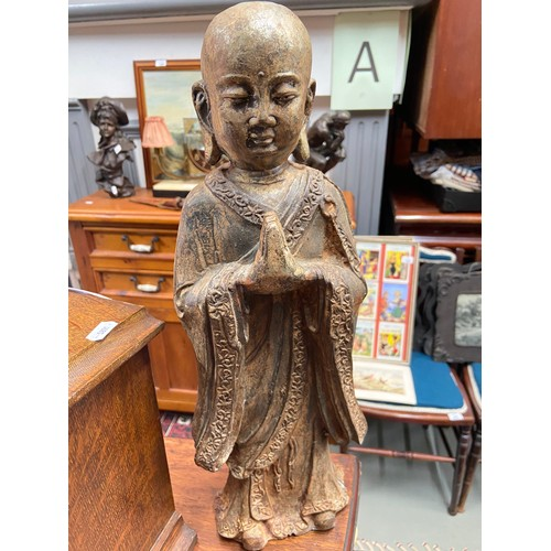 19 - A 19th century Chinese cast iron Monk figure.Showing signs of original gold colouring coming through...