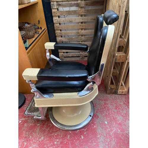 23 - A Vintage 1920's Barber Chair manufactured by Theo A Kochs Company Chigago. Designed with black leat...
