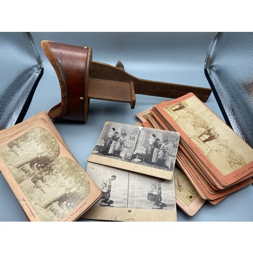 27 - Antique 'The Saturn Scope' Stereoscope with various Slides produced by The Great Western View Co....