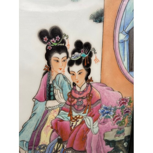 28 - A 20th century Chinese hand painted tile depicting Empress and hand maiden, signed by the artist. Fi...