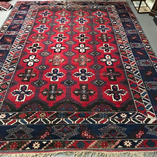 22 - A Large antique Aztec style hand made living room rug. Measures 408x302cm...