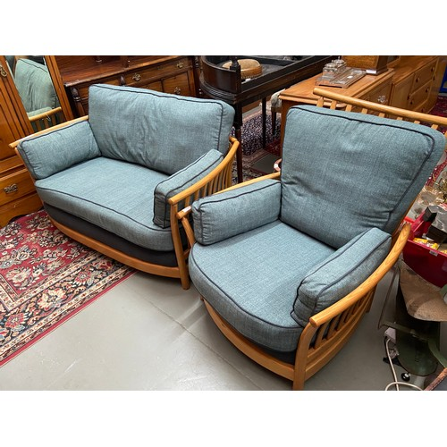 447C - A Vintage Ercol Renaissance light wood framed two seat sofa and single chair....