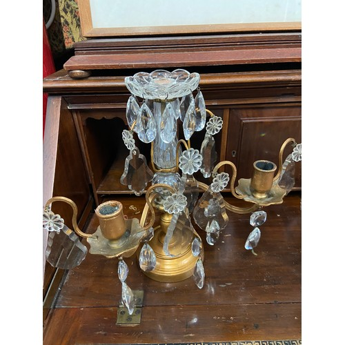 2D - A Pair of Regency cast metal and crystal crop let candle stick holders...