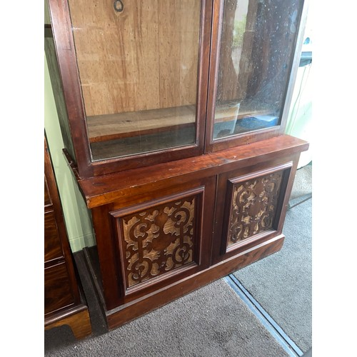 5D - A Victorian Mahogany two piece library bookcase. Designed with glass double doors....